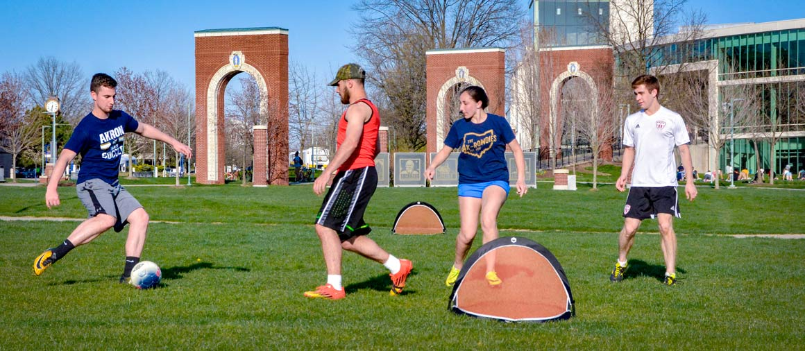 Students who applied for The University of Akron and were admitted playing soccer on the Coleman Common