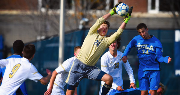 Student soccer player catches the ball and blocks the goal for The University of Akron.