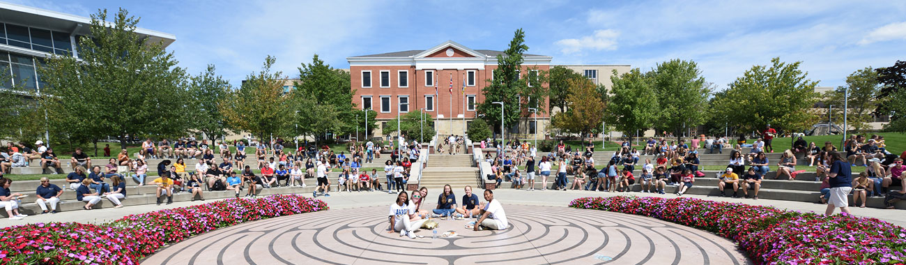 UA undergraduate students sitting on labyrinth on campus