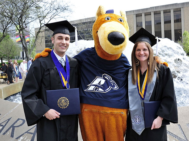 Two graduates during GradFest at The University of Akron