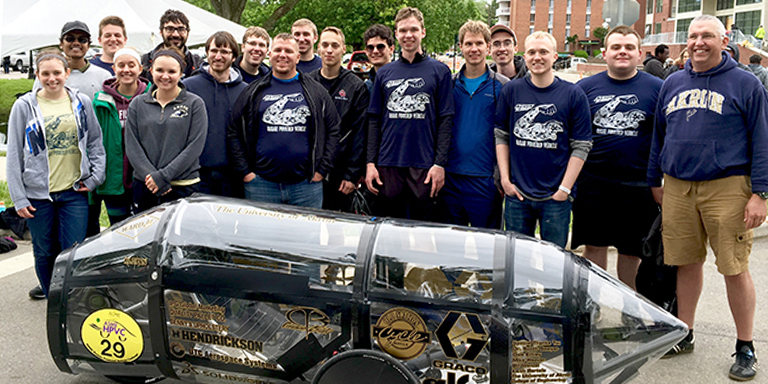 Mechanical Engineering students with Professor Sawyer and the human powered car they created at The University of Akron