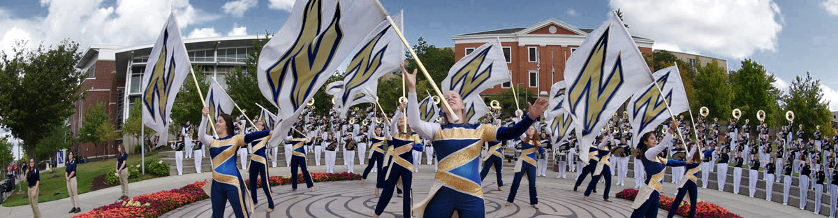 The University of Akron Marching Band performs on campus as part of a celebration.