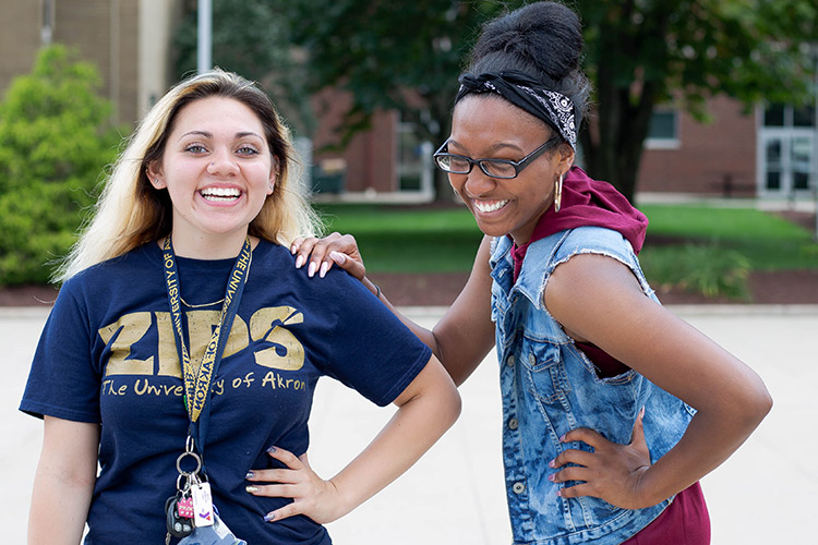 Two students from the Williams Honors College share a laugh in the common space on the North Quad