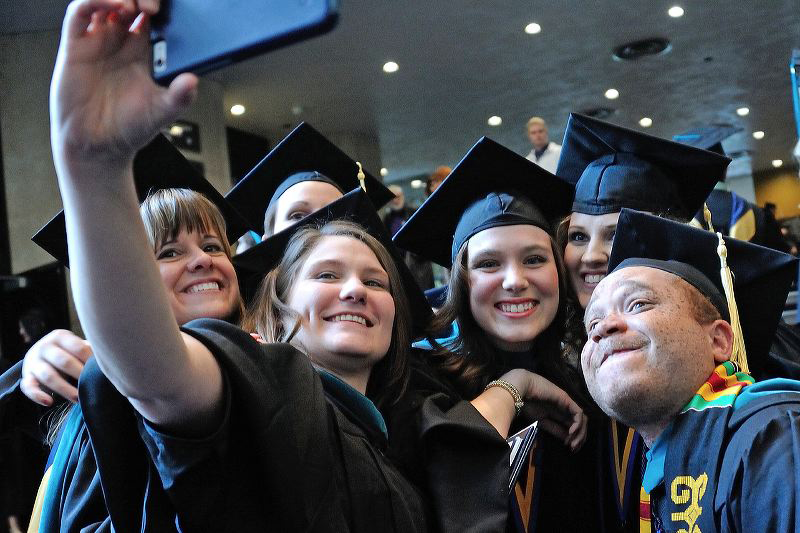 Students-in-caps-and-gowns-selfie