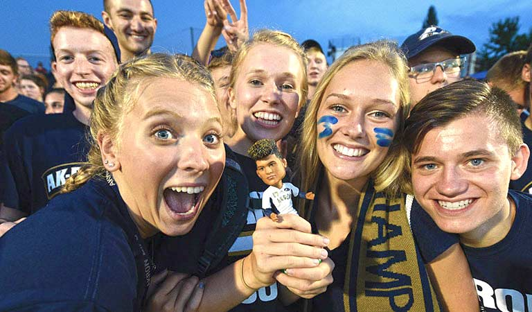 Students at a Zips soccer game