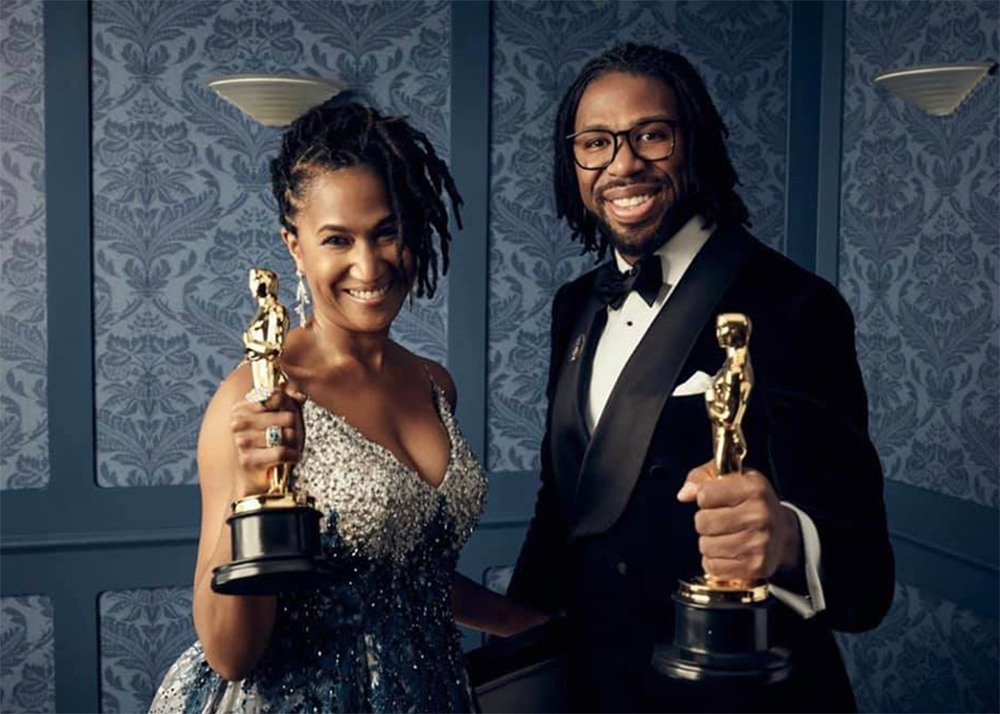 Karen Toliver and Matt Cherry holding Oscars