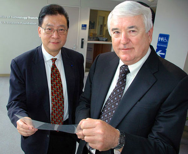 Dr. Stephen Z.D. Cheng and Dr. Frank Harris display an optical compensation film for liquid crystal displays (LCDs).