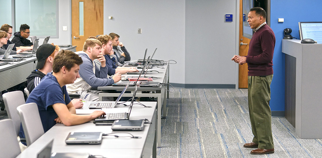 A professor in front of a cybersecurity class at The University of Akron