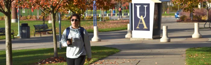 A student walking toward the Institutional Research office at The University of Akron