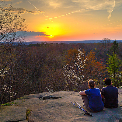 People enjoying Ledges Overlook at sunset