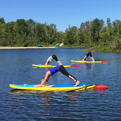 People doing yoga on paddleboards